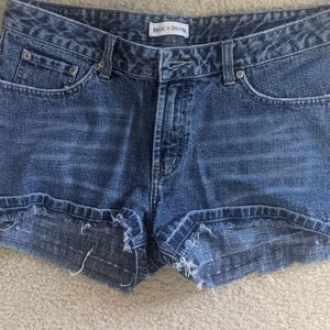 Buckle distressed shorts